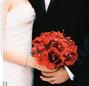 Sam carried a monochromatic bouquet of red amaryllis and ranunculus.
