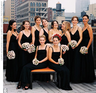The seven bridesmaids wore floor-length gowns of black chiffon with gray duchesse satin lining by Thread. Their bouquets were composed of white anemones with black centers, for a sleek, graphic effect.