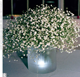 Baby's breath, when used on its own in clean, circular bunches, looked unexpectedly chic and evoked snow-covered trees. Tall vases flanked the ceremony space and lower ones dressed up cocktail tables.