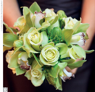 The bridesmaid bouquets consisted of Limona roses, green cymbidium orchids, and green ranunculuses, and the stems were finished in a complementary brown ribbon.