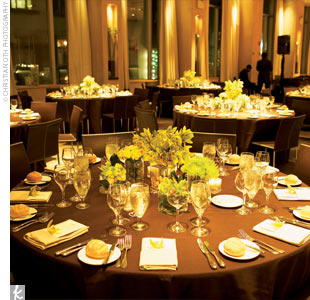 Each table had the same assortment of short square vases containing a single type of flower, all in the green palette. One vase at each table was filled with mini cymbidium orchids with river rocks filling the base. Chocolate brown tablecloths and brown leather chairs set off the bold green flowers.