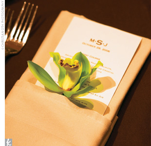 The dual monograms (ME and JS) on the invitations and programs became a single monogram (MSJ) on the place cards and menus once the ceremony was over.