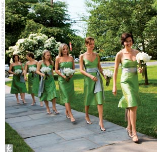 The seven bridesmaids wore dupioni silk dresses in apple green with cloud blue accents by Saeyoung Vu Couture. Each attendant chose a different style of dress. Wendys three nieces served as flower girls and donned dresses from Talbots Kids.