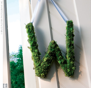 Wendy and Jim&#39;s first initials were created with moss and hung on the doors of the church.
