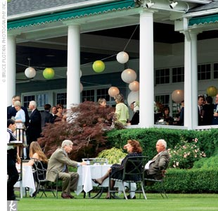 The cocktail hour was held on the country clubs lawn and large porch, which was decorated with green and white paper lanterns.