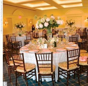 The 150 guests then moved inside for the green-hued reception. Table centerpieces were comprised of white peonies, Green Mist, white stock, white hydrangeas, and white roses. The couple also decorated alcoves of the room by filling birdbaths with cascading moss.