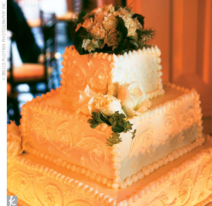 The three-tiered square confection featured red velvet cake and buttercream frosting.