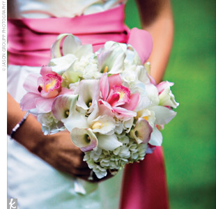 The bridal bouquet consisted of white roses, white mini calla lilies, and pink orchids, while the bridesmaid bouquets were made up of different shades of white, pink, and red roses.