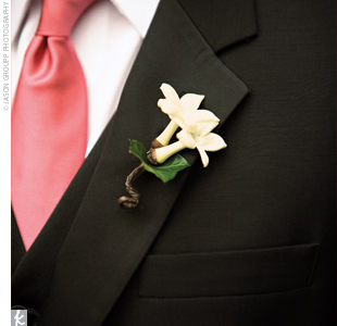 The groom wore a white mini calla lily, and his eight groomsmen wore stephanotis blossoms.