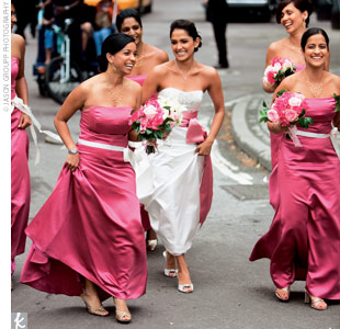 Teresa's eight bridesmaids all wore pink silk Vera Wang dresses. The matron of honor, Teresa's sister, wore a V-neck mermaid-style dress with dark pink back lacing, while the maids wore strapless dresses with corset details and rose grosgrain belts.