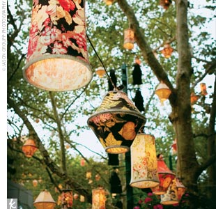 The cocktail hour was held in the restaurant's outdoor garden, where white tables and chairs were accented with candles and autumn-colored rose petals. Tea lamps strung from the trees lit up as the sun set.