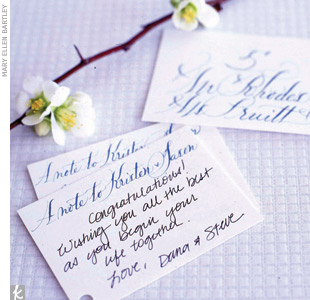 "First impressions are everything -- make yours count with an amazing escort card display. To keep things fresh, we hung gorgeous calligraphed cards (which double as guest book cards) from flowering branches. Ask your calligrapher to write ""A note to the newlyweds!"" on the back of each escort card (or have it printed) and leave pens and a card box s ..."