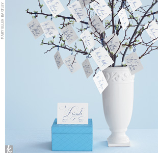 To help guests find their cards, set up separate trees -- one for friends and one for family, for instance -- and hang the cards in alphabetical order.