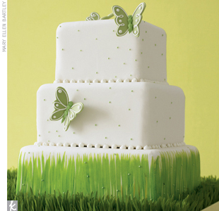 Create a cake display that shows off your wedding style. Hand-painted wheatgrass on white fondant plays up this cake's display, while whimsical butterflies and pale green dots sweeten each tier. 