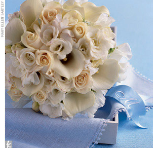 Theme #4: LettersFor the bridal bouquet, our florist went simple and classic: all white flowers (roses, calla lilies, sweet pea, and freesia). To tie in the motif du jour, we incorporated the same ribbon also used on the programs. Loosely tie the ribbon around the bouquet wrap and let it cascade over the brides hands. Whether guests can see the mo ...