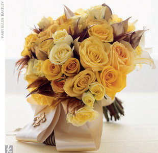 Theme #5: FlourishesOur florist accented a traditional bouquet of yellow roses with brown pheasant feathers, gilded camellia leaves, and a fleur-de-lis brooch on the ribbon wrap.
