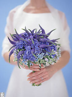 Smaller-scale bouquets are a good way to experiment with texture. Here, spiky blue veronica, a cost-cutting wildflower, pokes up above blue hydrangea and tweedia. Photo: Paul Costello