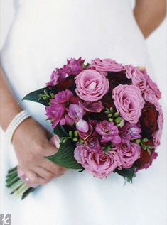This bouquet is pretty in purple -- made of lavender roses, astilbe and agapnathus.