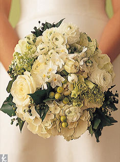 A round bouquet is the most classic in shape. This example includes tulips, ranunculuses, narcissi, lilacs, hydrangeas, and seeded eucalyptus.