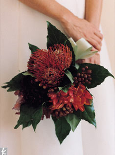This example is actually made of four mini bouquets, including a mix of gladiolous florets, orange tulips, orange protea, burgundy dahlias, fatsia japonica leaves and eucalyptus buds. The spiky protea adds a little bit more texture.