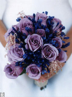 This bouquet gets its velvety hue from lavender roses, astilbe, and agapanthus.