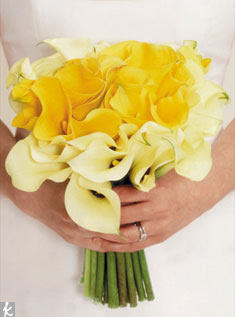 Yellow calla lilies in two shades makes this bouquet an armful of sunshine.