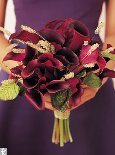 Dark purple calla lilies play off pewter, with hand-beaded flowers and velvet leaves adding a sparkly formal effect.