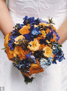 Color mixes beautifully with these light orange roses, blue delphinium, hydrangea, and iris.