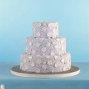 Inspired by your table linens? Cover your wedding cake in a complementary pattern. We took one of our favorite wedding colors -- lavender -- and draped tiers in a lace applique pattern that mimicked a dainty doily.