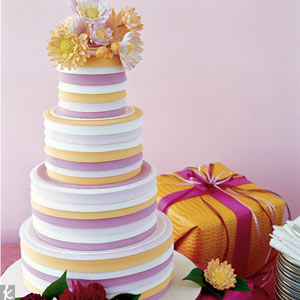 Incorporating several of your colors in gradient sugar-paste pleats is a simple (yet unexpected) way to carry out your theme.