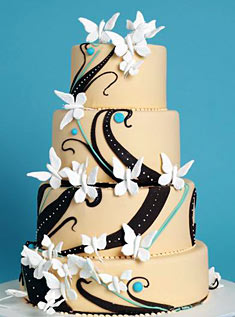 This four-tiered cake is decorated with modern scrollwork and dozens of tiny butterflies.
