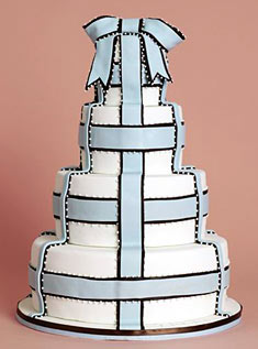This four-tiered cake is decorated with baby blue-and-brown fondant ribbon in a simple plaid pattern.