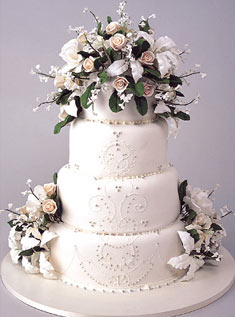 This four-tiered white cake that's bursting with roses and stephanotis reminds us of the grace of the Victorian era.