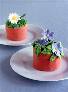 These mini-cakes -- replicas of single potted flowers -- make great individual desserts and can double as favors.