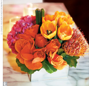 Short arrangements of roses, tulips, mums and hydrangea brought together the pinks and oranges in the lamps and linens.