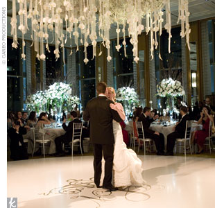 For a ceremony and reception that occurred in the same ballroom, Marina and her team had to think outside the box. For the Jewish ceremony, the ballroom's dance floor was covered in white canvas on top of which a stage was built. A chandelier was hung from the ceiling and draped with dozens of ribbons adorned with white phalaenopsis orchids. During ...