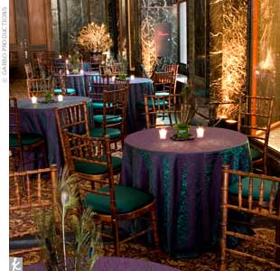 For an Indian wedding that took place in various rooms of the Chicago Cultural Center, Marina drew inspiration from the peacock -- a sacred icon in Indian culture -- for the cocktail hour. Tables were draped in iridescent purple and green linens, while cube-like vases were covered in galax leaves and packed with peacock feathers. Teal cushions adde ...