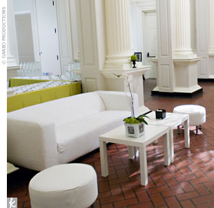 Marina and her team like to bring in sleek, white couches, ottomans, and tables so guests have a quiet place to relax and mingle outside the reception area.