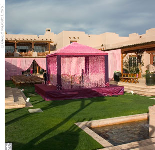 For an Indian ceremony that took place at dusk, Marina created a stunning, hot pink mandap with walls of threaded orchids that changed color, from dark pink to hot pink to pale pink.