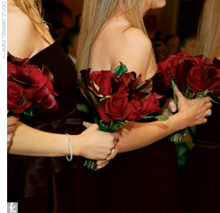 Each of Pam's bridesmaids carried calla lilies and roses in deep reds, which, next to their black dresses, conveyed the drama and elegance Pam was hoping for.
