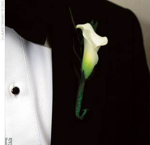 The groomsmen wore single, red rose boutonnieres, and Scott wore a single white calla lily.