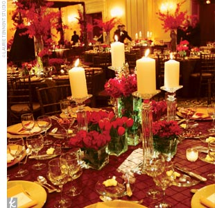 "Pillar and votive candles surrounded the centerpieces, and guests found turtle chocolate favors at their place settings. The stunning red flowers, along with votive and pillar candles, mahogany chairs, and chocolate brown linens with gold accents, made for a warm and romantic feel in the room, which was capped off by soft lighting. ""I really wanted ..."