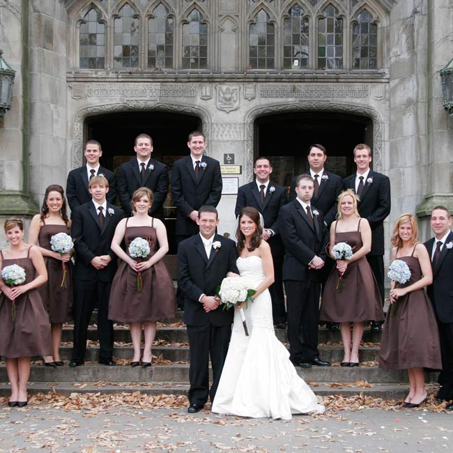 Each of Jennifer's six bridesmaids wore chocolate brown, tea-length dresses with fitted bodices, box-pleated skirts, and covered buttons by Vera Wang. They accessorized with teardrop earrings and chocolate brown sling backs. Matt wore a black, three-button, Ralph Lauren tuxedo with an ivory dress shirt and tie. His groomsmen wore black, two-button, ...