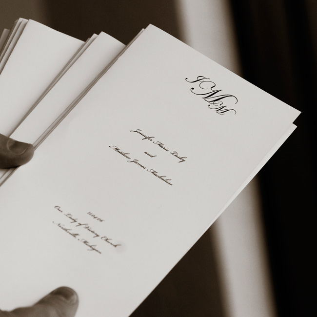 The couple's traditional programs featured a classic monogram.