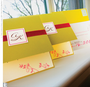 Amy and Kevin incorporated their theme into every element of the wedding. The invitations were simple but elegant, with a citron and ivory background and wrapped with a magenta satin ribbon.