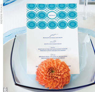 Serve up a tasteful paper presentation of the courses to come. This menu mimics the style of your invitation using a navy font combined with a modern sea blue eyelet design sailing across the top of the card.Go behind the scenes of this photo shoot