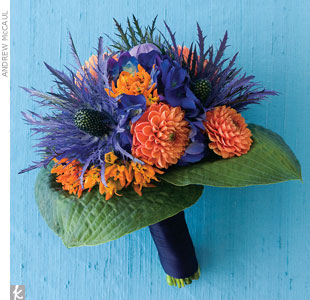 Give your bouquet a fresh-from-the-dunes feel with textural blooms. This bouquet combines eryhgium thistles with orange dahlias, hydrangeas, balloon flowers, hosta leaves, and asclepias. For a more subdued look, use the hosta leaves as the bouquet wrap.Go behind the scenes of this photo shoot