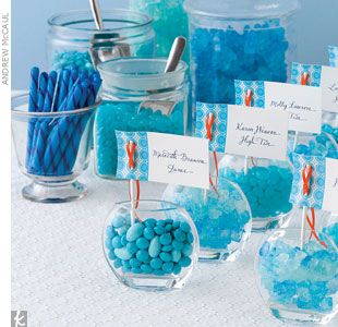 These whimsical place card holders double as sweet favors. Fill glass bud vases with candies in shades of turquoise and sea glass blue. We went overboard (literally) and chose an assortment of four of our favorites! Set up a candy bar on the side so guests can refill before heading home. 