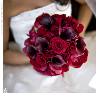 Danielles lush bouquet was filled with burgundy peonies, Black Magic roses, and burgundy mini calla lilies.
