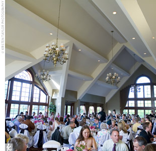 The natural elegance of the cathedral-style ceiling and wooden arches at Glen Oaks needed little decoration. White tablecloths and chair covers accented with black sashes brightened up the space, while pink accents added a touch of color and tealights brought a glow to the room.